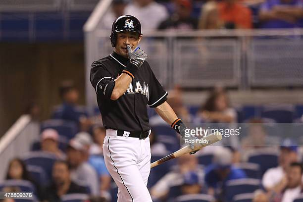 Ichiro Suzuki of the Miami Marlins walks back to the dugout after striking out during the fifth inning of the game against the Los Angeles Dodgers at...