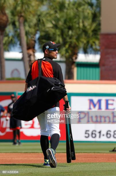 Ichiro Suzuki of the Miami Marlins walks off the field after batting practice before a spring training baseball game against the Minnesota Twins at...