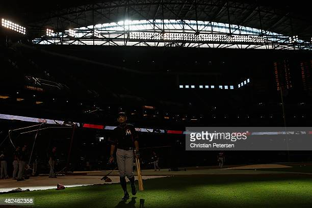Ichiro Suzuki of the Miami Marlins walks off the field after taking batting practice to the MLB game against the Arizona Diamondbacks at Chase Field...