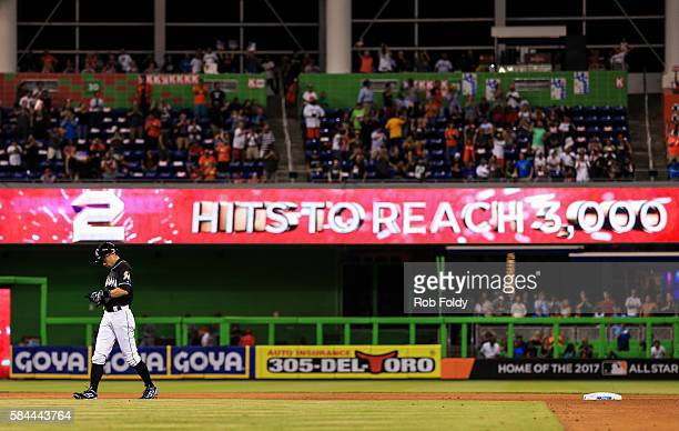 Ichiro Suzuki of the Miami Marlins walks on the field after hitting a double for his 2998th MLB career hit during the seventh inning of the game...