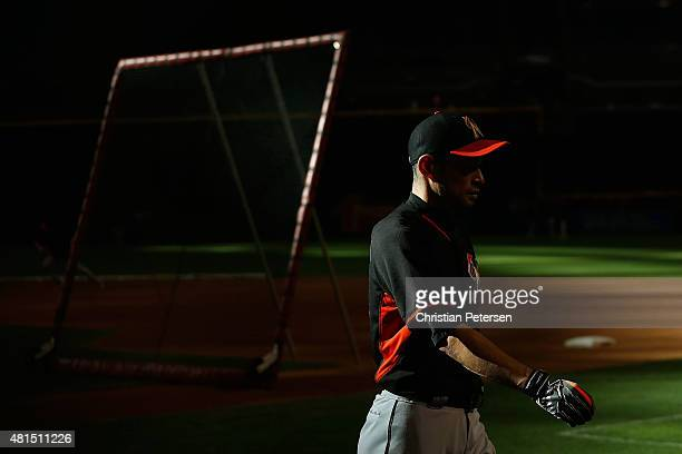 Ichiro Suzuki of the Miami Marlins walks to the dugout during batting practice to the MLB game against the Arizona Diamondbacks at Chase Field on...