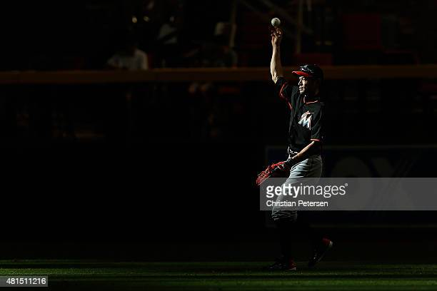 Ichiro Suzuki of the Miami Marlins warms up in the outfield during batting practice to the MLB game against the Arizona Diamondbacks at Chase Field...