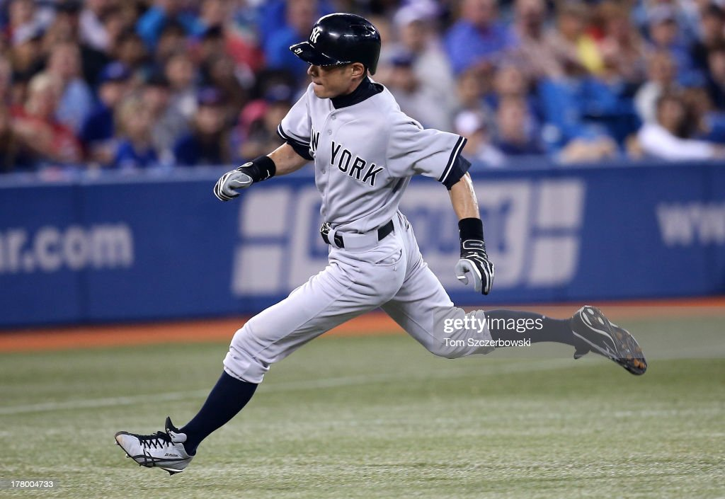 Ichiro Suzuki #31 of the New York Yankees advances from first base to third base in the fifth inning during MLB game action against the Toronto Blue Jays on August 26, 2013 at Rogers Centre in Toronto, Ontario, Canada.