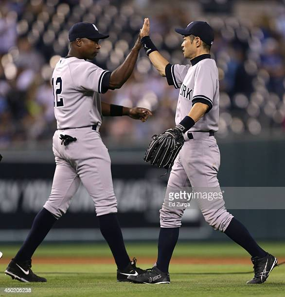 Ichiro Suzuki of the New York Yankees and Alfonso Soriano celebrate a 42 win over the Kansas City Royals at Kauffman Stadium on June 6 2014 in Kansas...