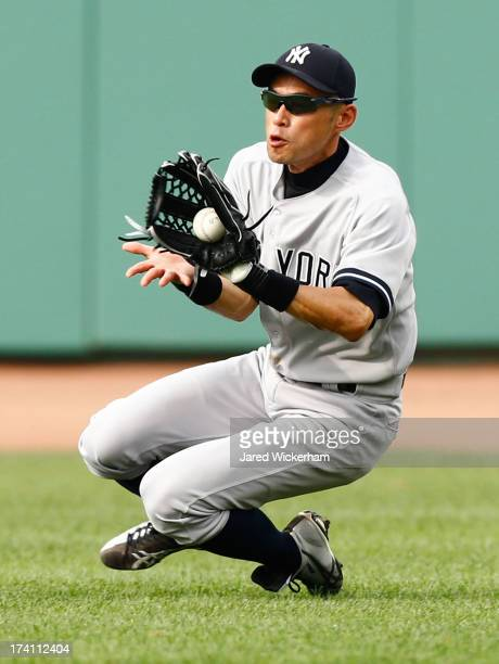 Ichiro Suzuki of the New York Yankees catches a line drive into right field against the Boston Red Sox during the game on July 20 2013 at Fenway Park...