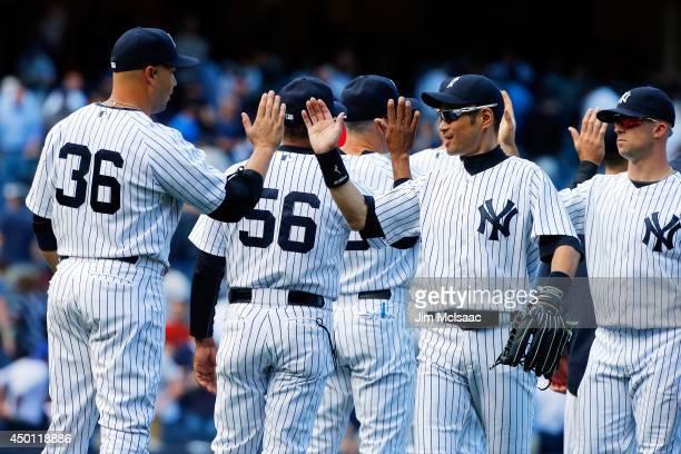 Ichiro Suzuki of the New York Yankees celebrates after defeating the Oakland Athletics with teammate Carlos Beltran at Yankee Stadium on June 5 2014...
