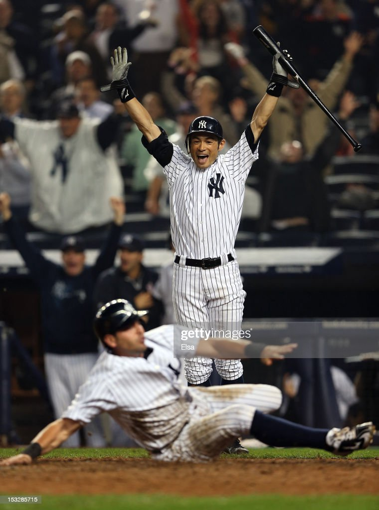 Ichiro Suzuki #31 of the New York Yankees celebrates after Francisco Cervelli #40 scored on a hit by Raul Ibanez in the bottom of the 12th inning against the Boston Red Sox on October 2, 2012 at Yankee Stadium in the Bronx borough of New York City.