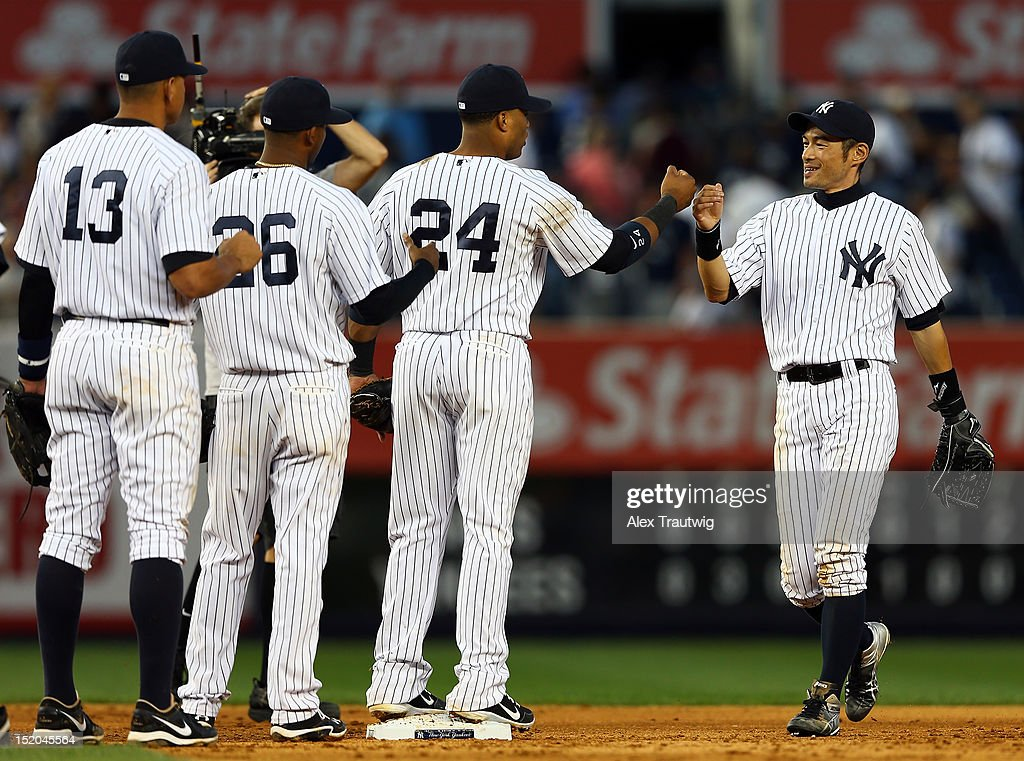 Ichiro Suzuki #31 of the New York Yankees celebrates the win with teammates Robinson Cano #24,Eduardo Nunez #26 and Alex Rodriguez #13 after the win over the Tampa Bay Rays on September 15, 2012 at Yankee Stadium in the Bronx borough of New York City.