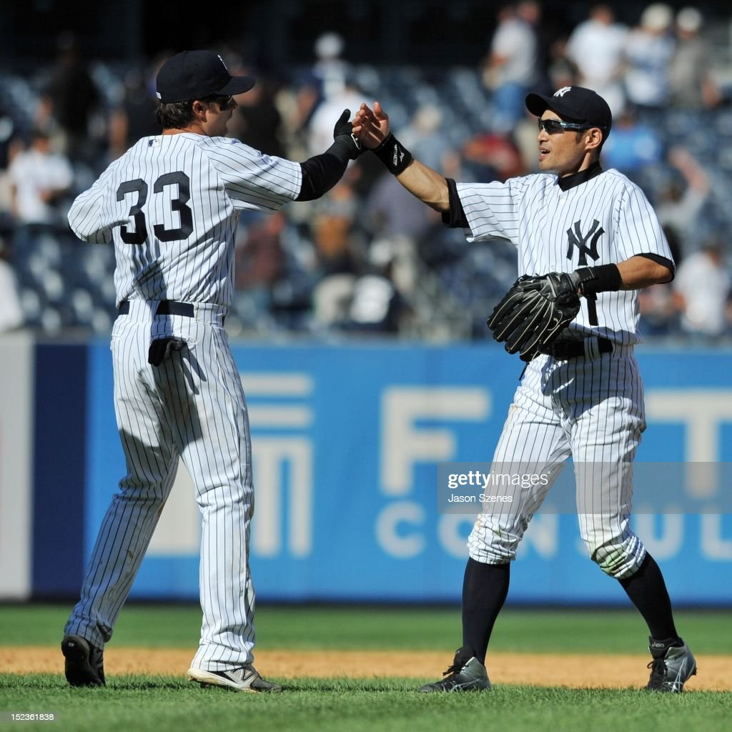 Ichiro Suzuki #31 of the New York Yankees (R) celebrates with his teammate Nick Swisher #33 (L) at the end of their teams ball game against the Toronto Blue Jays during the first game of a double header at Yankee Stadium on September 19, 2012 in the Bronx borough of New York City.