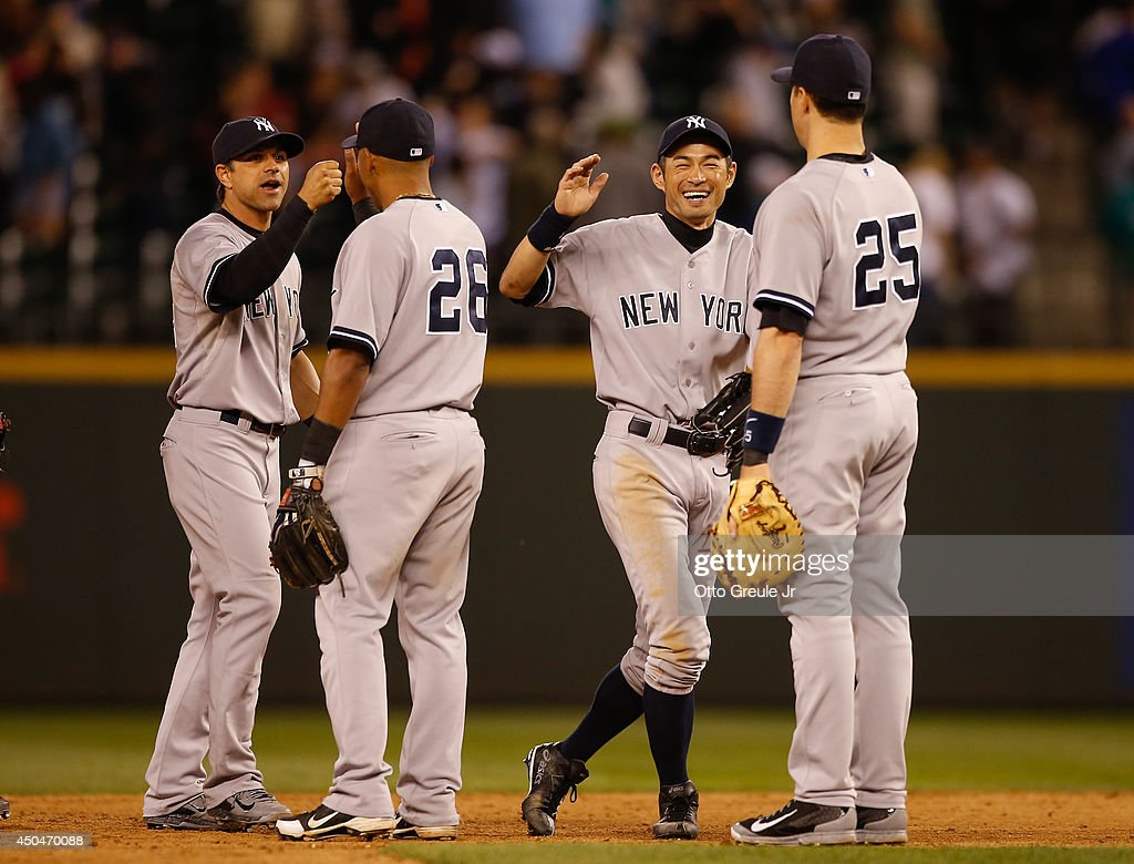 Ichiro Suzuki #31 of the New York Yankees celebrates with teammates after defeating the Seattle Mariners 4-2 at Safeco Field on June 11, 2014 in Seattle, Washington.