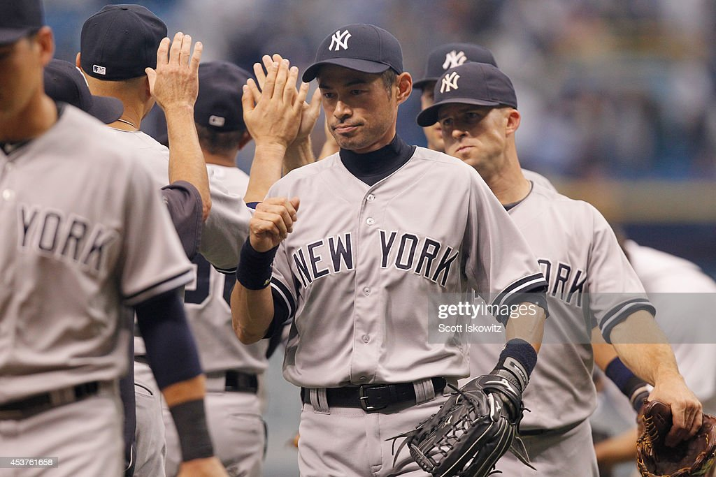 Ichiro Suzuki #31 of the New York Yankees celebrates with teammates after the game against the Tampa Bay Rays at Tropicana Field on August 17, 2014 in St Petersburg, Florida.