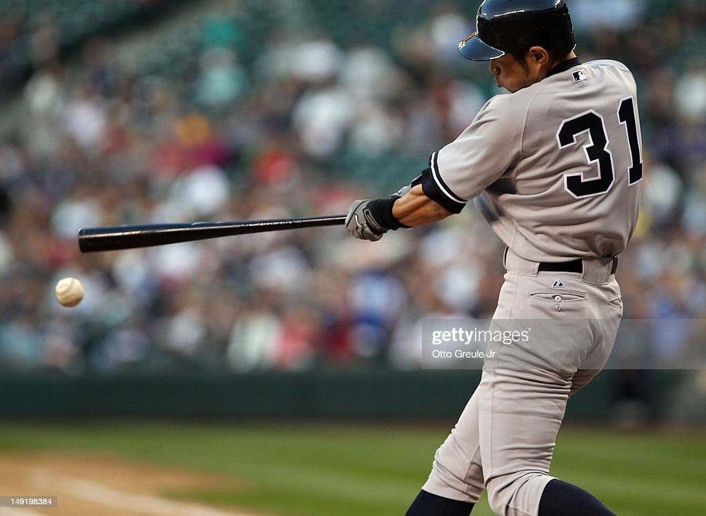 Ichiro Suzuki #31 of the New York Yankees doubles against the Seattle Mariners at Safeco Field on July 24, 2012 in Seattle, Washington.