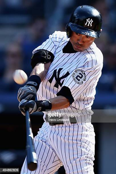 Ichiro Suzuki of the New York Yankees flies out in the fifth inning against the Kansas City Royals at Yankee Stadium on September 7, 2014 in the...
