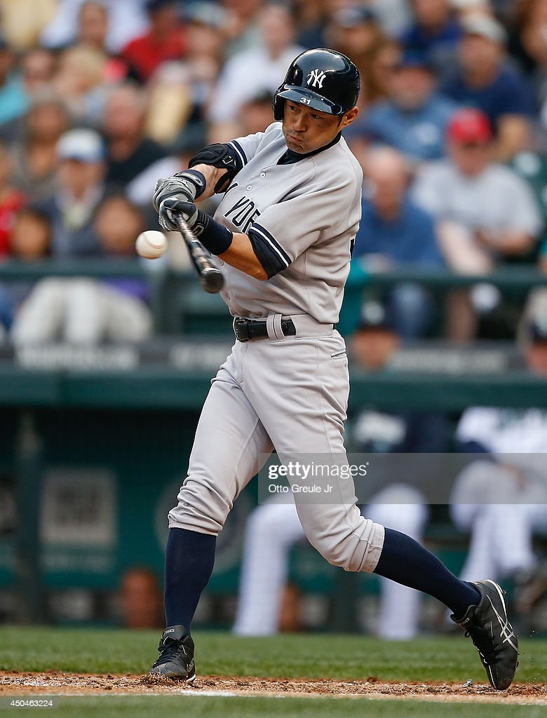 Ichiro Suzuki #31 of the New York Yankees flies out in the second inning against the Seattle Mariners at Safeco Field on June 11, 2014 in Seattle, Washington.