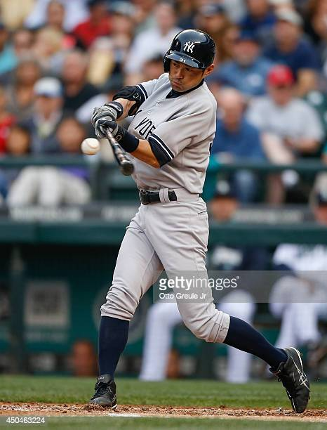 Ichiro Suzuki of the New York Yankees flies out in the second inning against the Seattle Mariners at Safeco Field on June 11 2014 in Seattle...