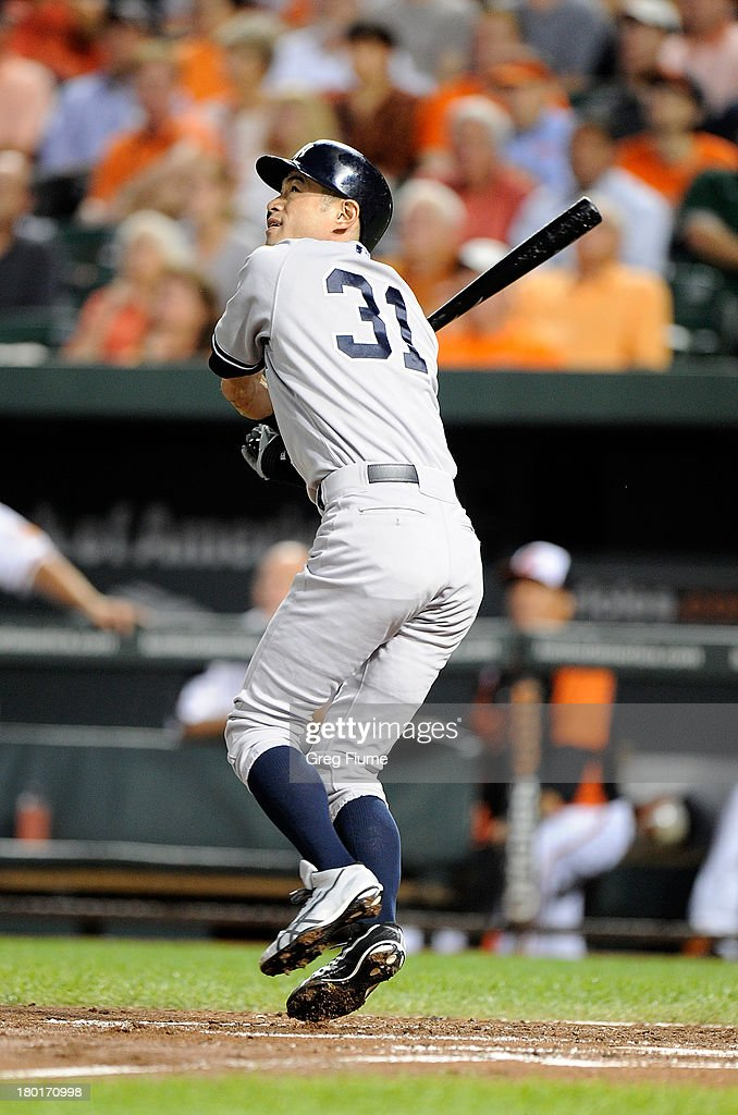 Ichiro Suzuki #31 of the New York Yankees flies out to left field in the second inning against the Baltimore Orioles at Oriole Park at Camden Yards on September 9, 2013 in Baltimore, Maryland.