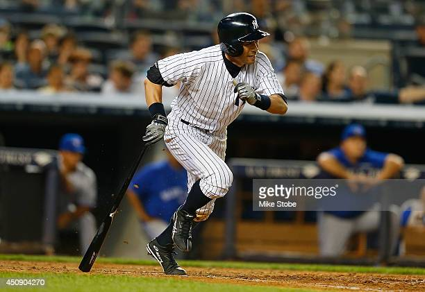Ichiro Suzuki of the New York Yankees flys out seventh inning against the Toronto Blue Jays at Yankee Stadium on June 19, 2014 in the Bronx borough...