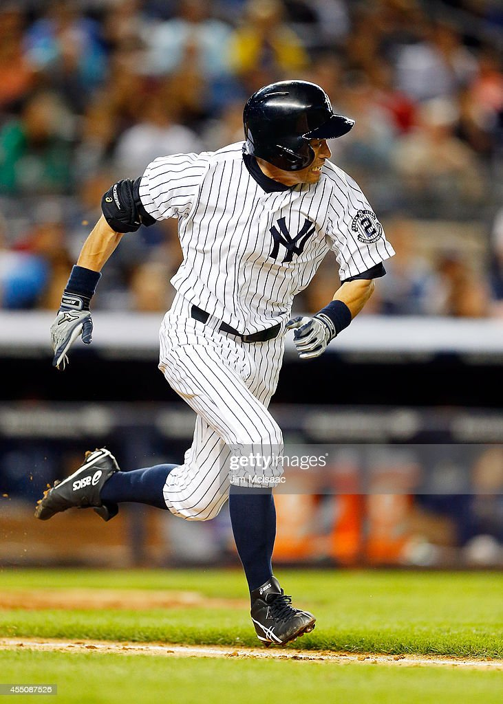 Ichiro Suzuki #31 of the New York Yankees follows runs out his seventh inning infield single against the Tampa Bay Rays at Yankee Stadium on September 9, 2014 in the Bronx borough of New York City.