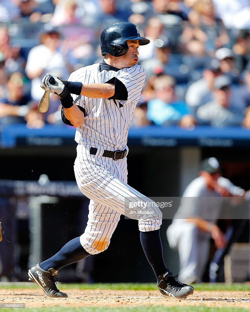 Ichiro Suzuki #31 of the New York Yankees follows through on a sixth inning two run base hit against the Chicago White Sox at Yankee Stadium on August 24, 2014 in the Bronx borough of New York City.
