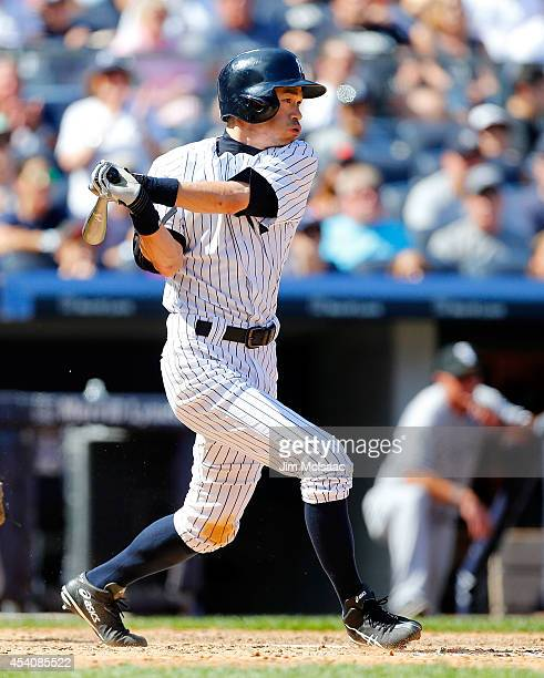 Ichiro Suzuki of the New York Yankees follows through on a sixth inning two run base hit against the Chicago White Sox at Yankee Stadium on August 24...