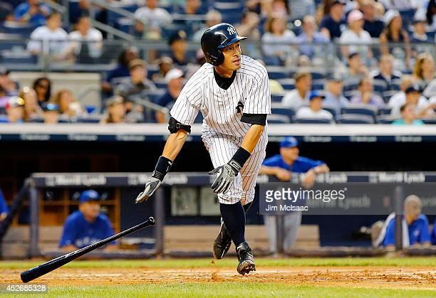 Ichiro Suzuki of the New York Yankees follows through on a third inning three run home run against the Toronto Blue Jays at Yankee Stadium on July 25...