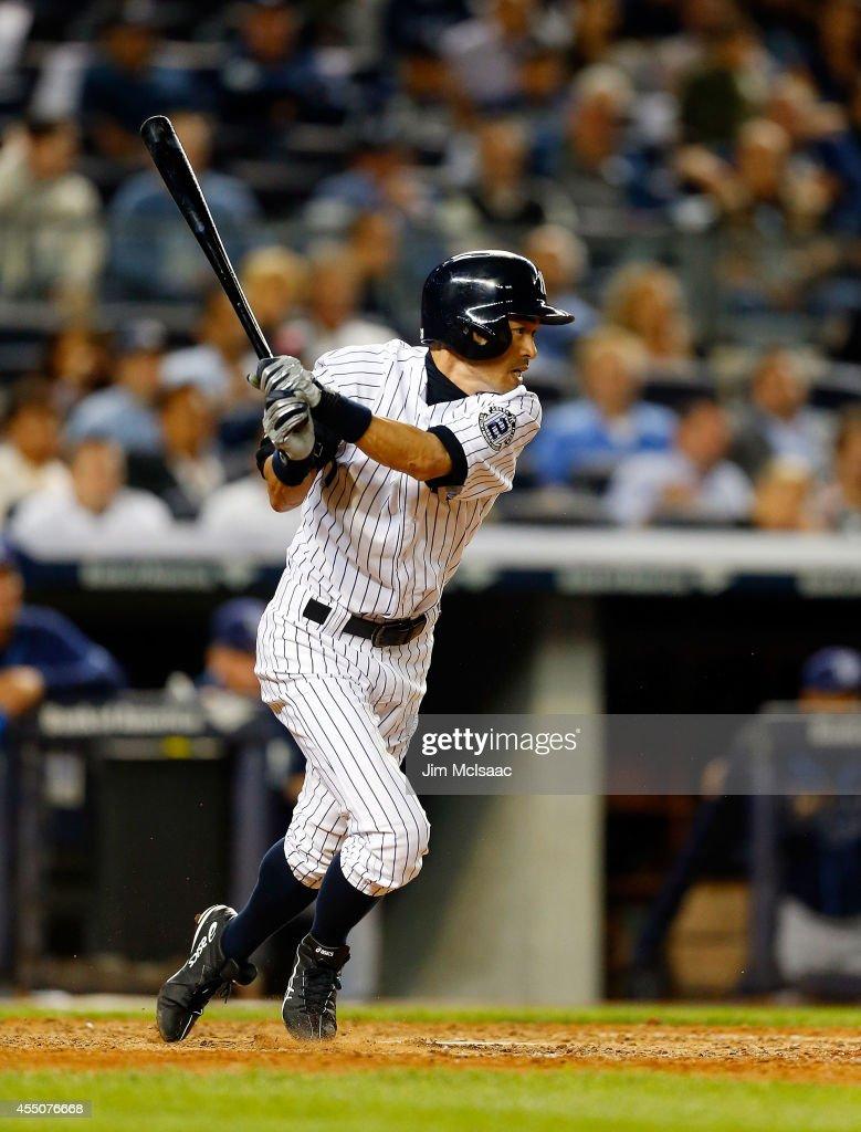 Ichiro Suzuki #31 of the New York Yankees follows through on seventh inning infield single against the Tampa Bay Rays at Yankee Stadium on September 9, 2014 in the Bronx borough of New York City.