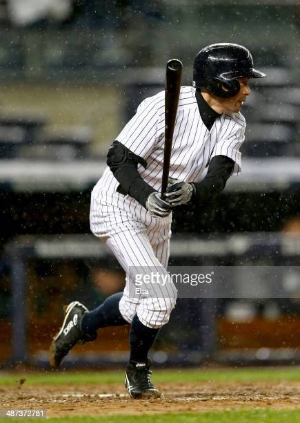 Ichiro Suzuki of the New York Yankees gets a hit in the ninth inning against the Seattle Mariners on April 29 2014 at Yankee Stadium in the Bronx...