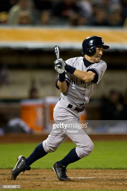 Ichiro Suzuki of the New York Yankees hits a ground ball for an out against the Oakland Athletics during the seventh inning at Oco Coliseum on June...