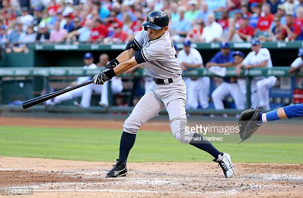 Ichiro Suzuki of the New York Yankees hits a RBI single against the Texas Rangers at Rangers Ballpark in Arlington on July 23 2013 in Arlington Texas