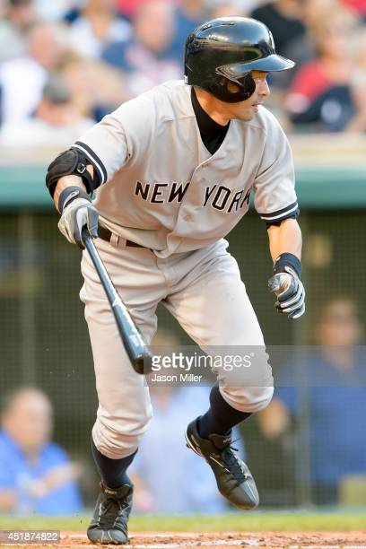 Ichiro Suzuki of the New York Yankees hits a single during the second inning against the Cleveland Indians at Progressive Field on July 8 2014 in...