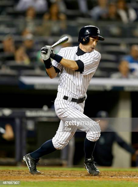 Ichiro Suzuki of the New York Yankees hits a single in the ninth inning against the Seattle Mariners on May 1 2014 at Yankee Stadium in the Bronx...