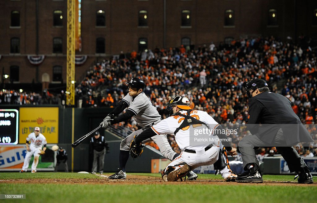 Ichiro Suzuki #31 of the New York Yankees hits a single in the seventh inning during Game Two of the American League Division Series against the Baltimore Orioles at Oriole Park at Camden Yards on October 8, 2012 in Baltimore, Maryland.