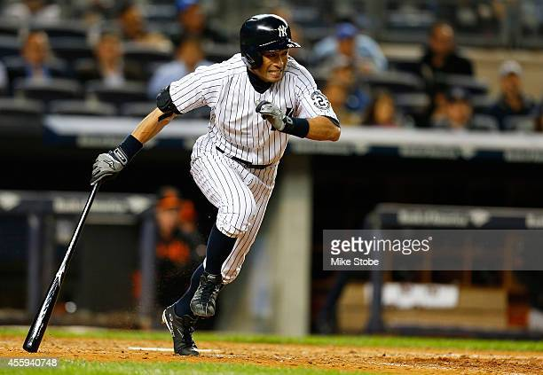 Ichiro Suzuki of the New York Yankees hits a single in the seventh inning against the Baltimore Orioles at Yankee Stadium on September 22 2014 in the...