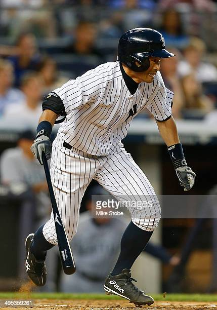 Ichiro Suzuki of the New York Yankees hits a two run single in the fourth inning against the Seattle Mariners at Yankee Stadium on June 2 2014 in the...