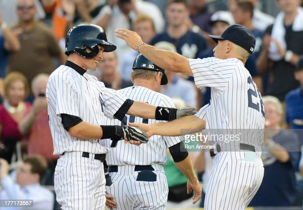 Ichiro Suzuki of the New York Yankees is congratulated by manager Joe Girardiafter his 4000th career hit on a single in the 1st inning of the New...