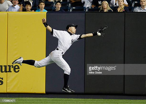 Ichiro Suzuki of the New York Yankees is unable to catch a double off the bat of Matt Joyce of the Tampa Bay Rays in the eighth inning at Yankee...