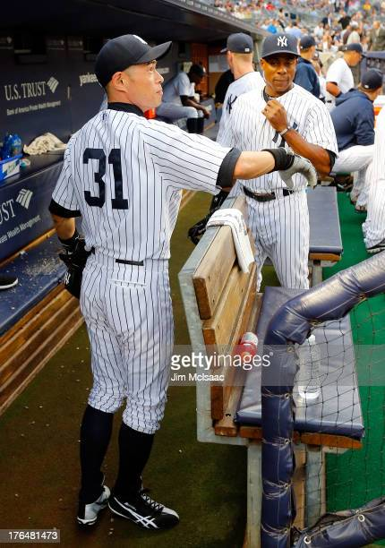 Ichiro Suzuki of the New York Yankees looks on from the dugout before a game against the Los Angeles Angels of Anaheim at Yankee Stadium on August...