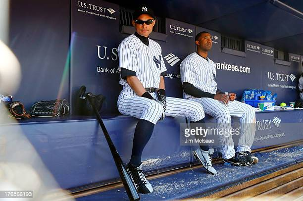 Ichiro Suzuki of the New York Yankees looks on from the dugout during a game against the Los Angeles Angels of Anaheim at Yankee Stadium on August...