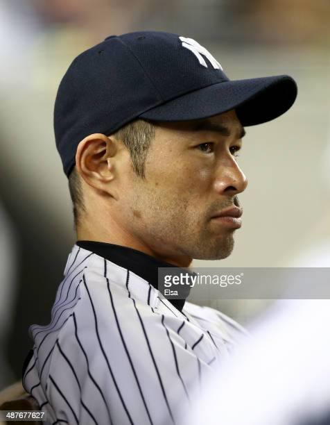 Ichiro Suzuki of the New York Yankees looks on from the dugout in the fifth inning against the Seattle Mariners on May 1 2014 at Yankee Stadium in...