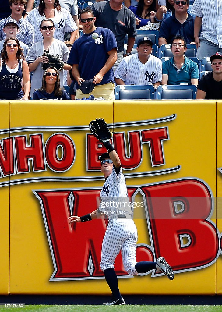 Ichiro Suzuki #31 of the New York Yankees makes a catch for a first inning out against the Detroit Tigers at Yankee Stadium on August 11, 2013 in the Bronx borough of New York City. The Yankees defeated the Tigers 5-4.