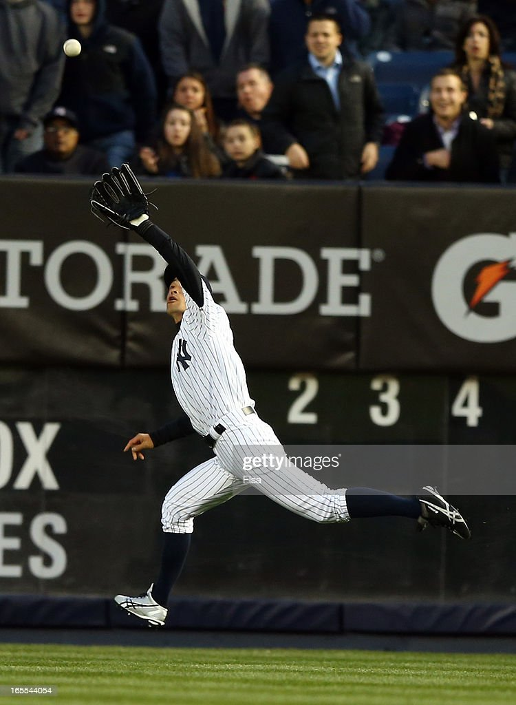 Ichiro Suzuki #31 of the New York Yankees makes the catch for the out in the first inning against the Boston Red Sox n April 4, 2013 at Yankee Stadium in the Bronx borough of New York City.