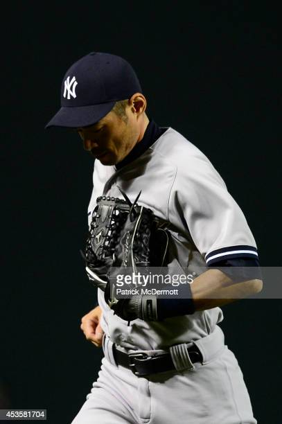 Ichiro Suzuki of the New York Yankees runs back to the dugout after the eighth inning during a baseball game against the Baltimore Orioles at Oriole...