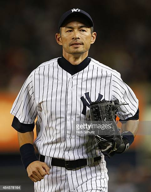 Ichiro Suzuki of the New York Yankees runs off the field during the second inning against the Boston Red Sox in a MLB baseball game at Yankee Stadium...