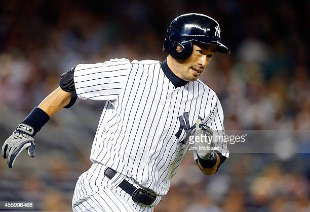 Ichiro Suzuki of the New York Yankees runs out a fifth inning double against the Baltimore Orioles at Yankee Stadium on September 23, 2014 in the...