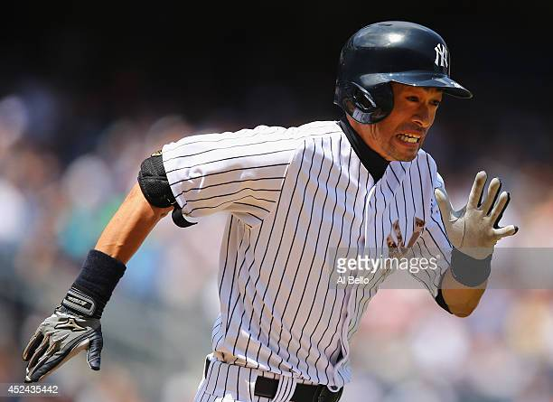 Ichiro Suzuki of the New York Yankees runs to first base ain the fourth inning against the Cincinnati Reds during their game at Yankee Stadium on...