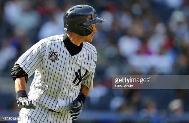 Ichiro Suzuki of the New York Yankees runs to first base as he watches his line drive to left field get caught in the ninth inning against the...