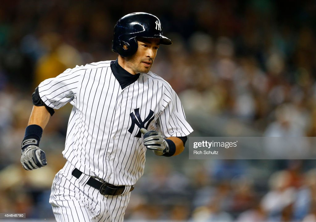 Ichiro Suzuki #31 of the New York Yankees runs to first base as he hits a single in the third inning against the Boston Red Sox during a MLB baseball game at Yankee Stadium on September 4, 2014 in the Bronx borough of New York City.