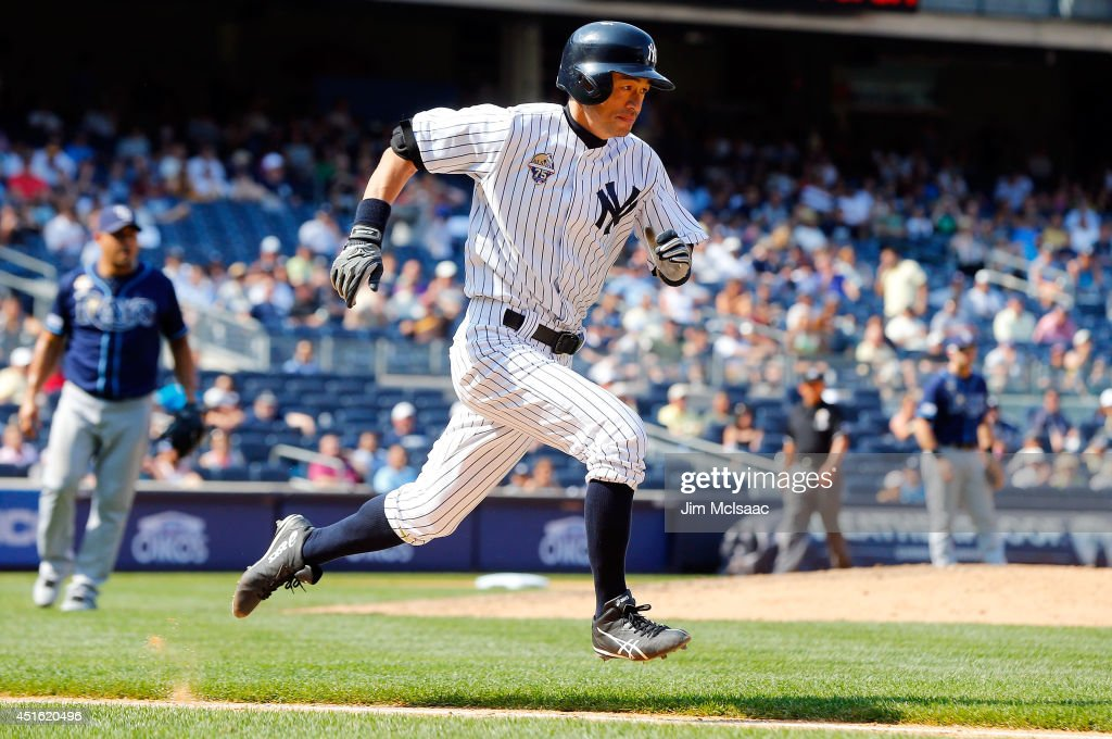 Ichiro Suzuki #31 of the New York Yankees runs to first base as he grounds out in the eighth inning against the Tampa Bay Rays at Yankee Stadium on July 2, 2014 in the Bronx borough of New York City.