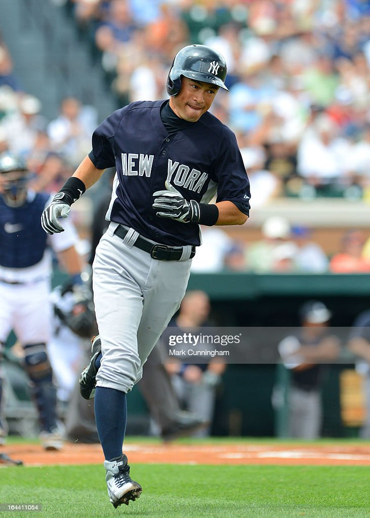 Ichiro Suzuki #31 of the New York Yankees runs to first base during the spring training game against the Detroit Tigers at Joker Marchant Stadium on March 23, 2013 in Lakeland, Florida. The Tigers defeated the Yankees 10-6.