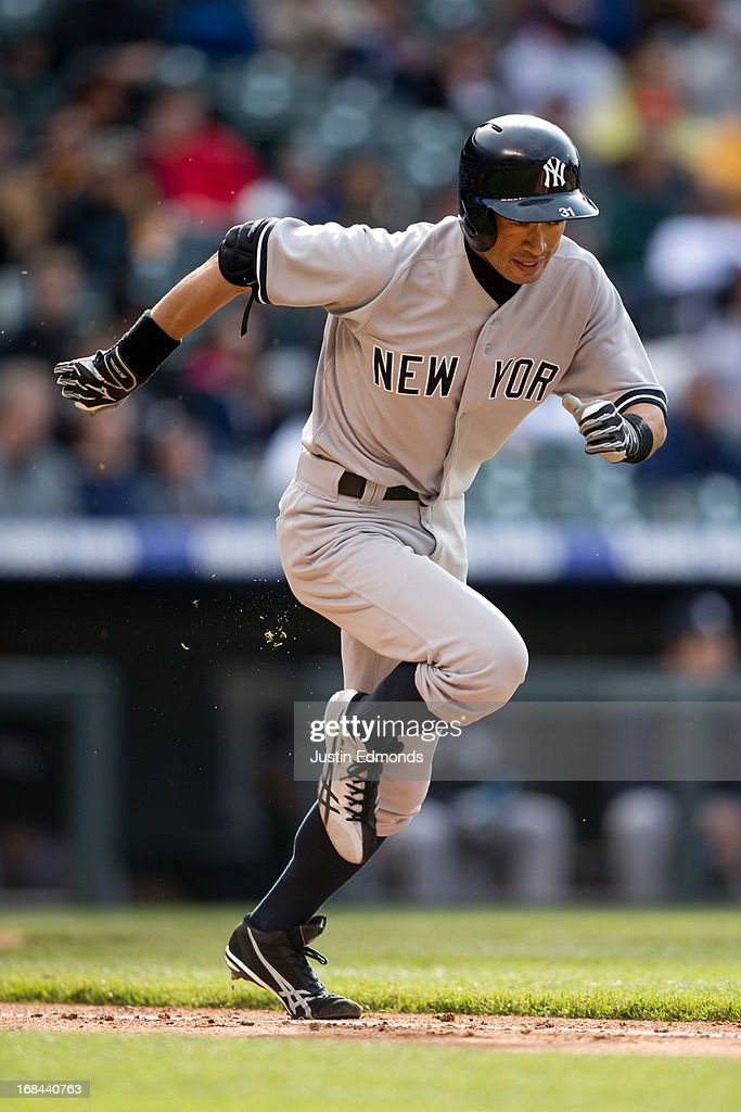 Ichiro Suzuki #31 of the New York Yankees runs up the first base line on his way to grounding out against the Colorado Rockies at Coors Field on May 9, 2013 in Denver, Colorado. The Yankees defeated the Rockies 3-1 to win the series.